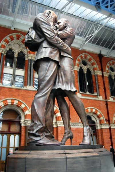 Close up of embracing couple St Pancras station